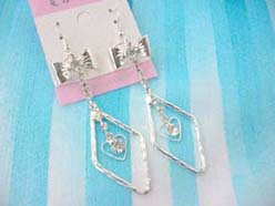 fashion accessory diamond frame holding heart earring