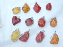 A wholesale package faux amber charm in group