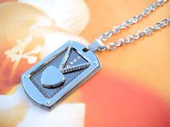 Rectangular pendant holding a mini heart necklace