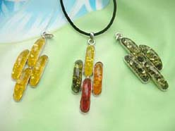 Four long round faux amber pendant