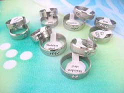 Stainless steel rings with cut out designs