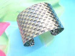 hammered puffs and basket woven design costume jewelry bangle
