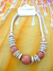 silver coil necklace, large solid color bead in middle