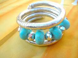 snake wrapped bracelet with four turquoise beads