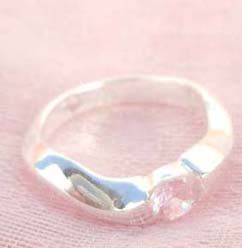 Great stamped 925 sterling silver curvy band with pinky cz ring