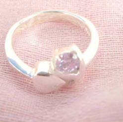 Outstanding 925. stamped silver ring with heart shape beside holding pinky cz design