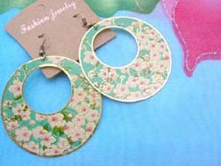 green earring with pinkish white florals